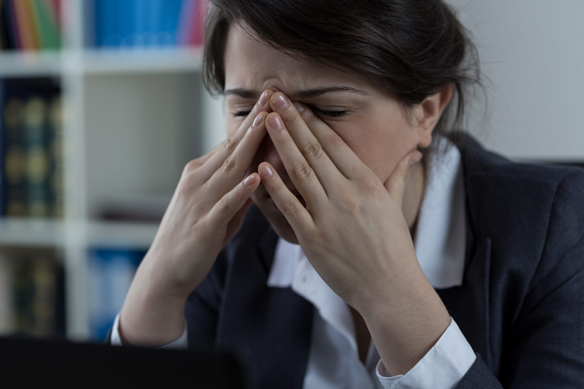 Business worker at office with sinus pain